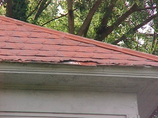 View of a worn edging that requires extra work by the Roof Menders' crew