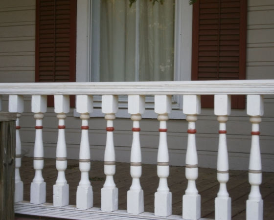 Porch features and shutters adds attractive detail
