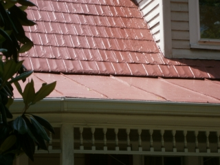 Final top coat with a sheen blend the three styles of old metal roofing