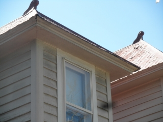 Distinctive ornaments on red shingle roof