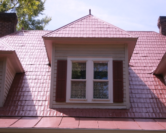 Restored red single roof dormer